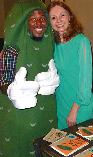 "At the book signing for ""101 Things To Do With a Pickle,"" Eliza poses with Miles LaGree - World's Best Dancing Pickle"
