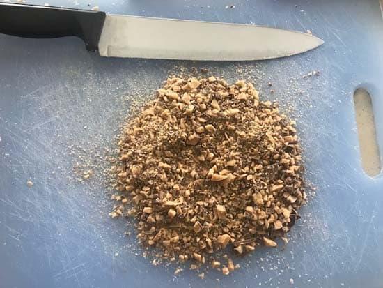 cutting board with knife and chopped Heath bars