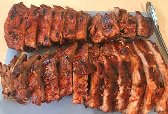 Barbecued ribs on a cutting board