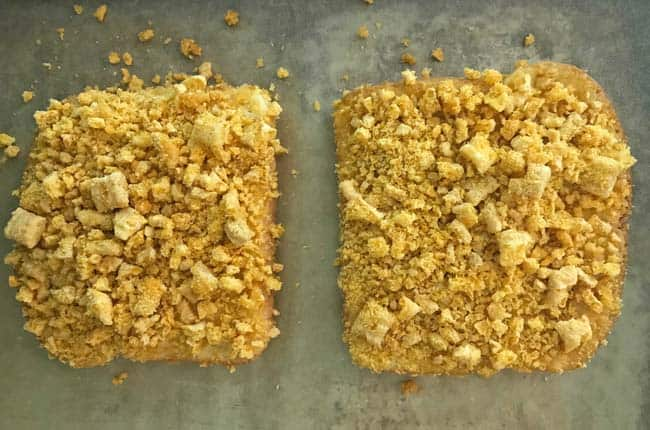 Bread slices coated with Cap'n Crunch crumbs