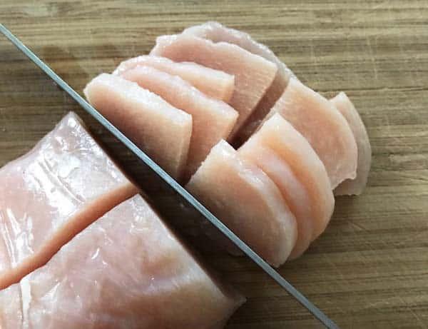 Slicing partially frozen chicken