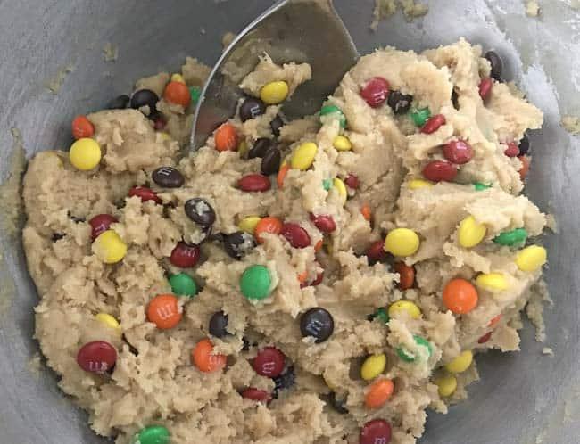 stirring m&ms in cookie dough recipe